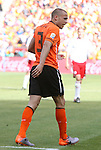 14 JUN 2010: John Heitinga (NED) walks off the field with blood on his hand, from checking the back of his head after a collision. The Netherlands National Team defeated the Denmark National Team 2-0 at Soccer City Stadium in Johannesburg, South Africa in a 2010 FIFA World Cup Group E match.