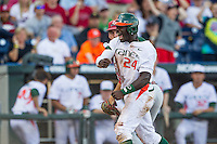 Miami Hurricanes outfielder Jacob Heyward (24) celebrates after scoring during the NCAA College baseball World Series against the Arkansas Razorbacks  on June 15, 2015 at TD Ameritrade Park in Omaha, Nebraska. Miami beat Arkansas 4-3. (Andrew Woolley/Four Seam Images)