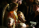 It was standing room only at the last Mass at St. John Cantius in Detroit, Sunday, Oct. 28, 2007. Here, Jillian Kalis,7, of Wyandotte leans on one of the angels holding holy water at the back of the church where her and her family found a place to stand. ..SUSAN TUSA/Detroit Free Press