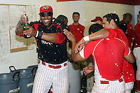 September 7 2008:  Xavier Scruggs of the Batavia Muckdogs, Class-A affiliate of the St. Louis Cardinals, celebrate winning the Pinckney Division after a game at Dwyer Stadium in Batavia, NY.  Photo by:  Mike Janes/Four Seam Images