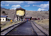 View of tracks and wate tank at Osier.<br /> D&amp;RGW  Osier, CO  Circa 1980