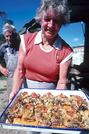 Muttonbirder presents lunch of roasted muttonbirds (shearwaters).  Great Dog Island, Tasmania.