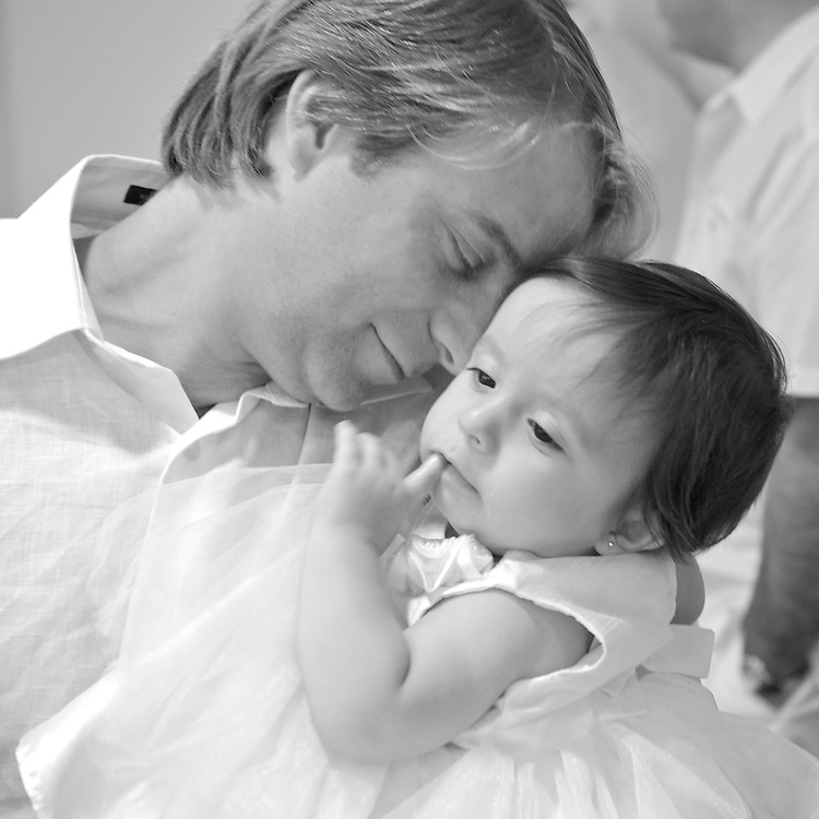 A touching moment with dad at baby's first birthday party.