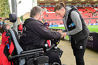 Lincoln City's Aaron Lewis signs an autograph for a fan<br /> <br /> Photographer Chris Vaughan/CameraSport<br /> <br /> The EFL Sky Bet League One - Lincoln City v Sunderland - Saturday 5th October 2019 - Sincil Bank - Lincoln<br /> <br /> World Copyright © 2019 CameraSport. All rights reserved. 43 Linden Ave. Countesthorpe. Leicester. England. LE8 5PG - Tel: +44 (0) 116 277 4147 - admin@camerasport.com - www.camerasport.com