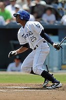 Asheville Tourists right fielder Julian Yan #25 swings at a pitch during a game against the Lexington Legends at McCormick Field on June 16, 2013 in Asheville, North Carolina. The Tourists won the game 8-7. (Tony Farlow/Four Seam Images)