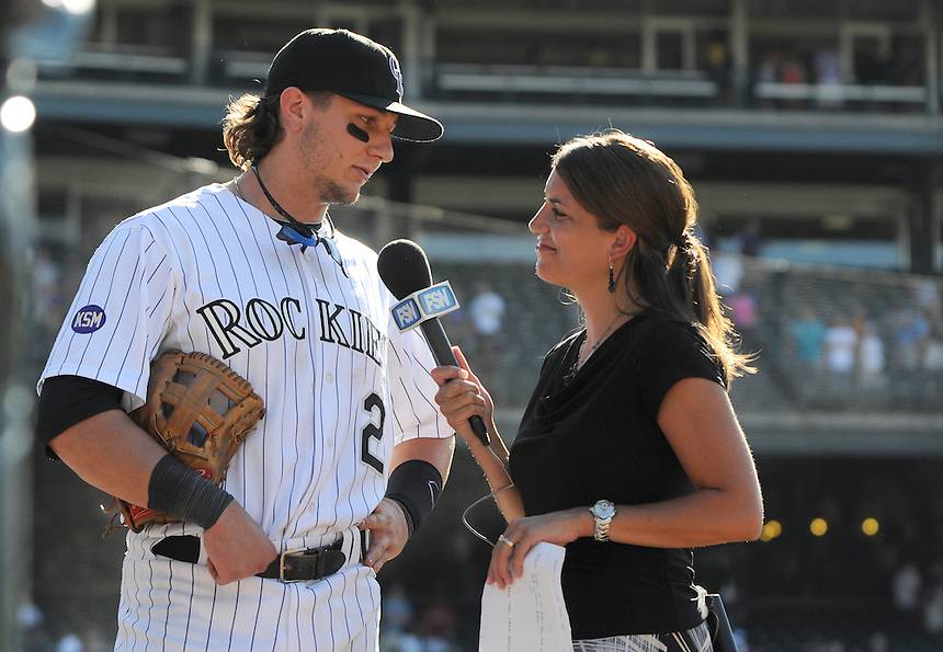25 AUGUST 2010: Colorado Rockies shortstop Troy Tulowitzki (2) is interviewed by Fox Sports Rocky Mountain on-field reporter Alanna Rizzo after a game where the Rockies staged an 9-run comeback during a regular season Major League Baseball game between the Colorado Rockies and the Atlanta Braves at Coors Field in Denver, Colorado. The Rockies won 12-10 after being down 10-1 in the 3rd inning.   *****For Editorial Use Only*****