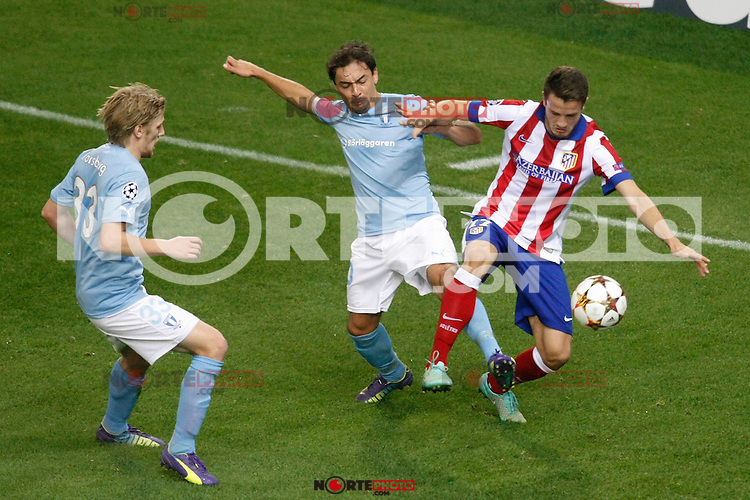 Atletico de Madrid´s Javier Manquillo (R) and Malmo´s Ricardinho and Forsberg during Champions League soccer match between Atletico de Madrid and Malmo at Vicente Calderon stadium in Madrid, Spain. October 22, 2014. (ALTERPHOTOS/Victor Blanco)