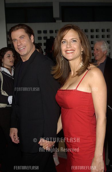 Actor JOHN TRAVOLTA & wife actress KELLY PRESTON at the Los Angeles premiere of his new movie The Punisher..April 12, 2004