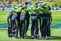 The Pakistan team huddles before the start of play during the One Day International cricket match between the NZ Black Caps and Pakistan at the Basin Reserve in Wellington, New Zealand on Saturday, 6 January 2018. Photo: Dave Lintott / lintottphoto.co.nz