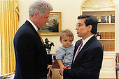 United States President Bill Clinton met with the US Secretary of Energy Federico Pena in the Oval Office of the White House in Washington, DC on April 6, 1998.  Also pictured is Secretary Pena's son, Ryan.<br /> Mandatory Credit:  Barbara Kinney - White House via CNP