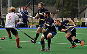 Hockey - Mens Invitational 4 Nations event at Sportscotland National Centre, Largs - Scotland V England - Scotland defender Dan Coultas (right) drag-flicks the ball past his own players (Adam McKenzie and Niall Stott - foreground) and England midfielder Richard Alexander to open the scoring in the match. England recovered to win 5-1 - Picture by Donald MacLeod - 13.06.11 - 07702 319 738 - www.donald-macleod.com - clanmacleod@btinternet.com