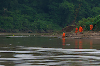 Monks on the banks of the Mekong River at Luang Prabang, Laos