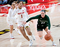 COLLEGE PARK, MD - DECEMBER 8: Bri Rozzi #22 of Loyola moves away from Shakira Austin #1 of Maryland during a game between Loyola University and University of Maryland at Xfinity Center on December 8, 2019 in College Park, Maryland.