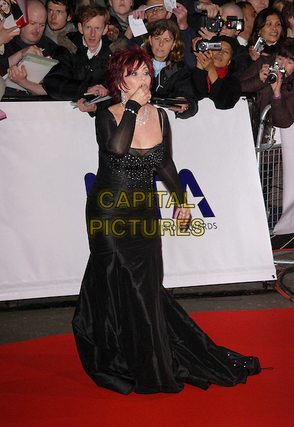 SHARON OSBOURNE .The National Television Awards, Royal Albert Hall, London, England..October 31st, 2007.TV full length black dress sheer sleeves hand mouth gesture funny eating .CAP/ROS.©Steve Ross/Capital Pictures