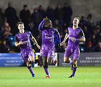 Port Vale's Emmanuel Oyeleke, centre celebrates scoring his side's equalising goal to make the score 1-1<br /> <br /> Photographer Andrew Vaughan/CameraSport<br /> <br /> The EFL Sky Bet League Two - Lincoln City v Port Vale - Tuesday 1st January 2019 - Sincil Bank - Lincoln<br /> <br /> World Copyright &copy; 2019 CameraSport. All rights reserved. 43 Linden Ave. Countesthorpe. Leicester. England. LE8 5PG - Tel: +44 (0) 116 277 4147 - admin@camerasport.com - www.camerasport.com
