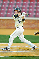Joe Napolitano #12 of the Wake Forest Demon Deacons follows through on his swing against the UNC-Asheville Bulldogs at Wake Forest Baseball Park on February 28, 2012 in Winston-Salem, North Carolina.  The Demon Deacons defeated the Bulldogs 9-8.  (Brian Westerholt/Four Seam Images)