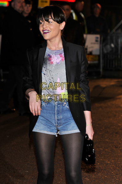 "JAIME WINSTONE.Attends the UK Film Premiere of director Martin Scorsese's  ""Shine A Light"" documentary about The Rolling Stones, held at Odeon cinema, Leicester Square, London, England,  .2nd April 2008.half length Jamie purple lipstick dyed brown hair brunette denim hotpants shorts black blazer jacket tights grey paint splattered print t-shirt top bag purse .CAP/PL.©Phil Loftus/Capital Pictures."