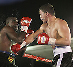 Joey Gilbert throws a punch against Ivan Stovall.   Photo by Tom Smedes.
