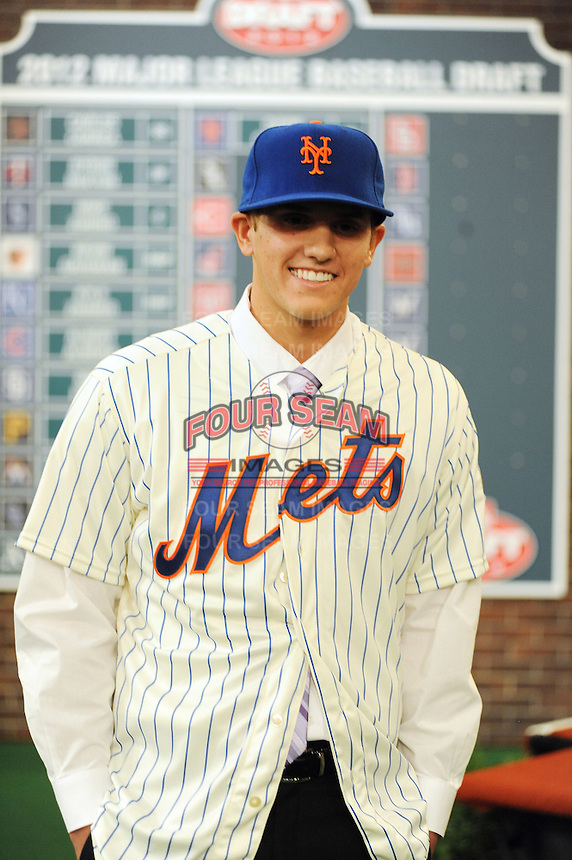 Shortstop Gavin Cecchini (Barbe H.S.) the number tweleve overall pick to the New York Mets during the MLB Draft on Monday June 04,2012 at Studio 42 in Secaucus, NJ.   (Tomasso DeRosa / Four Seam Images)