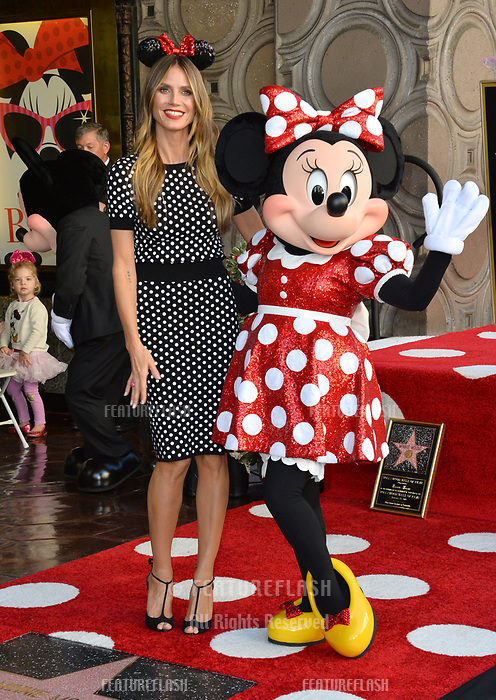 Heidi Klum &amp; Minnie Mouse at the Hollywood Walk of Fame Star Ceremony honoring Disney character Minnie Mouse, Los Angeles, USA 22 Jan. 2018<br /> Picture: Paul Smith/Featureflash/SilverHub 0208 004 5359 sales@silverhubmedia.com
