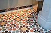 This custom bathroom floor features Granada Grande, a waterjet mosaic shown in polished Emperador Dark, Verde Luna, Rosa Verona, Calacatta Tia, and Giallo Reale, is part of the Miraflores collection by Paul Schatz for New Ravenna.<br /> <br /> -Photo courtesy of Paul Schatz