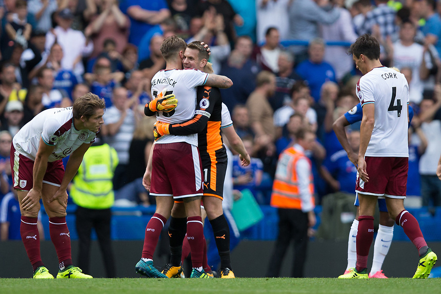 Burnley's Thomas Heaton celebrates with team mate Jeff Hendrick at full time<br /> <br /> Photographer Craig Mercer/CameraSport<br /> <br /> The Premier League - Chelsea v Burnley - Saturday August 12th 2017 - Stamford Bridge - London<br /> <br /> World Copyright &copy; 2017 CameraSport. All rights reserved. 43 Linden Ave. Countesthorpe. Leicester. England. LE8 5PG - Tel: +44 (0) 116 277 4147 - admin@camerasport.com - www.camerasport.com