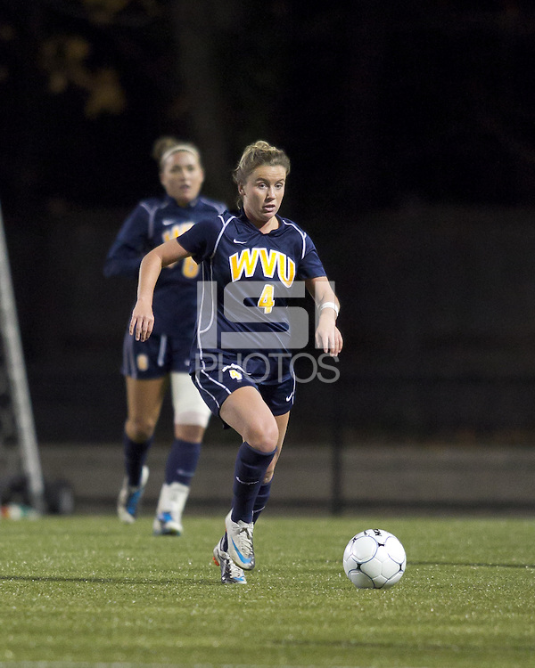 "West Virginia midfielder Bri Rodriguez (4) brings the ball forward. Boston College defeated West Virginia, 4-0, in NCAA tournament ""Sweet 16"" match at Newton Soccer Field, Newton, MA."