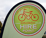 Electric bike hire point banner in house garden Shottisham, Suffolk, Banner for hire point for electric bike hire point