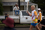 A man perched on a truck watching Batonbearer Jacina van Slobbe carrying the Baton as the Queen's Baton Relay visited Roma. In the host state of Queensland the Queen's Baton will visit 83 communities from Saturday 3 March to Wednesday 4 April 2018. As the Queen's Baton Relay travels the length and breadth of Australia, it will not just pass through, but spend quality time in each community it visits, calling into hundreds of local schools and community celebrations in every state and territory. The Gold Coast 2018 Commonwealth Games (GC2018) Queen's Baton Relay is the longest and most accessible in history, travelling through the Commonwealth for 388 days and 230,000 kilometres. After spending 100 days being carried by approximately 3,800 batonbearers in Australia, the Queen's Baton journey will finish at the GC2018 Opening Ceremony on the Gold Coast on 4 April 2018.