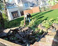BNPS.co.uk (01202 558833)<br /> Pic: CorinMesser/BNPS<br /> <br /> Stephen Powell with wall which collapsed into his garden.<br /> <br /> Homeowners are counting the cost today after a 'tornado' hit a south coast town overnight.<br /> <br /> Residents in Barton-on-Sea, Hants, were woken at 4am as the twister blasted its way through the town like an 'express train'. <br /> <br /> The strength of the winds of up to 80mph shook numerous houses, sending roof tiles smashing to the ground.<br />  <br /> A 30ft long brick wall collapsed under the strength of the gusts while fence panels were flung through the air.<br /> <br /> Part of a garden shed that had been picked up by the tornado smashed a hole through the windscreen of a car.