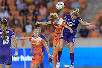 Rebecca Moros (4) of the Houston Dash and Becky Edwards (14) of the Orlando Pride go up for a header at the same time on Friday, May 20, 2016 at BBVA Compass Stadium in Houston Texas. The Orlando Pride defeated the Houston Dash 1-0.