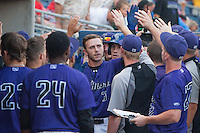 Tulsa Drillers second baseman Trevor Story (3) high fives teammates after hitting a home run during the Texas League game against the Frisco RoughRiders at ONEOK field on August 15, 2014 in Tulsa, Oklahoma  The RoughRiders defeated the Drillers 8-2.  (William Purnell/Four Seam Images)