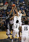 Utah State's Jalen Moore (14) and Elston Jones (50) fight for a rebound with Nevada's AJ West (3), Lucas Stivrins (34) and Tyron Criswell, (2) during an NCAA college basketball game in Reno, Nev., on Tuesday, Jan. 20, 2015. Utah State won 70-54. (AP Photo/Cathleen Allison)