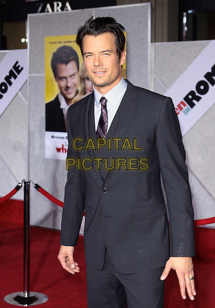 "JOSH DUHAMEL .Attending the Los Angeles Premiere of ""When In Rome"" held at The El Capitan Theater, Hollywood, CA, USA, .27th January 2010..arrivals half length hands  suit tie grey gray purple .CAP/ADM/TC.©T. Conrad/AdMedia/Capital Pictures."