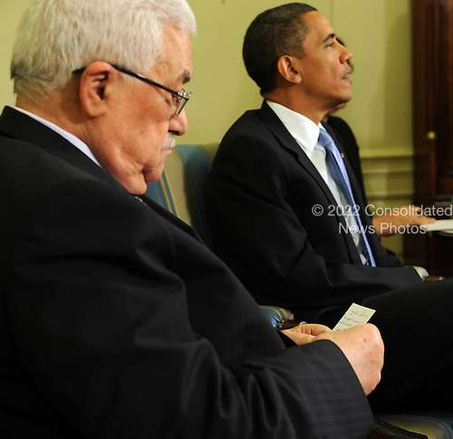 President Mahmoud Abbas of the Palestinian Authority looks over notes before speaking to the media after meeting with U.S. President Barack Obama in the Oval Office of the White House in Washington on Wednesday, June 9, 2010.  .Credit: Roger L. Wollenberg - Pool via CNP