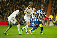 Real Madrid´s Raphael Varane and Alvaro Arbeloa and Deportivo de la Coruna's Ivan Cavaleiro during 2014-15 La Liga match between Real Madrid and Deportivo de la Coruna at Santiago Bernabeu stadium in Madrid, Spain. February 14, 2015. (ALTERPHOTOS/Luis Fernandez) /NORTEphoto.com