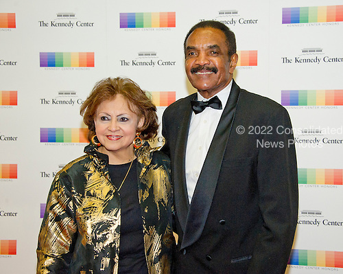 Former NFL running back Calvin Hill and his wife, Janet,  arrive for the formal Artist's Dinner honoring the recipients of the 39th Annual Kennedy Center Honors hosted by United States Secretary of State John F. Kerry at the U.S. Department of State in Washington, D.C. on Saturday, December 3, 2016. The 2016 honorees are: Argentine pianist Martha Argerich; rock band the Eagles; screen and stage actor Al Pacino; gospel and blues singer Mavis Staples; and musician James Taylor.<br /> Credit: Ron Sachs / Pool via CNP