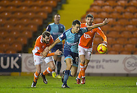 Mark Yeates of Blackpool holds back Luke O'Nien of Wycombe Wanderers during the The Checkatrade Trophy match between Blackpool and Wycombe Wanderers at Bloomfield Road, Blackpool, England on 10 January 2017. Photo by Andy Rowland / PRiME Media Images.