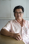61 year old Lay Kee Tee, a former pig farmer and a  survivor of the Nipah virus poses for a portrait at a Chinese cafe in Bukit Pelandok in Nageri Sembilan, Malaysia on October 16th, 2016. <br /> In September 1998, a virus among pig farmers (associated with a high mortality rate) was first reported in the state of Perak in Malaysia. Dr. Chua investigated and discovered the virus and it was later named, Nipah Virus. The outbreak in Malaysia was controlled through the culling of &gt;1 million pigs.