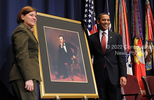 Washington, DC - March 12, 2009 -- United States President Barack Obama and Lt. Gen. Frances C. Wilson, United States Marine Corps, president of the National Defense University, unveil a portrait of Abraham Lincoln during the dedication of the Abraham Lincoln Hall at the National Defense University at Ft. McNair in Washington on Thursday, March 12, 2009.  .Credit: Roger L. Wollenberg - Pool via CNP