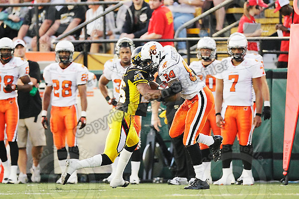 July 31, 2009; Hamilton, ON, CAN; Hamilton Tiger-Cats defensive back Chris Thompson (26) tackles BC Lions wide receiver Emmanuel Arceneaux (84). CFL football: BC Lions vs. Hamilton Tiger-Cats at Ivor Wynne Stadium. The Tiger-Cats defeated the Lions 30-18. Mandatory Credit: Ron Scheffler. Copyright (c) 2009 Ron Scheffler.