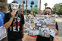 "Phoenix, Arizona (July 28, 2012) - About three hundred people marched to protest the second anniversary of the approval of some provisions of the SB 1070 immigration law. The march, called ""No Papers, No Fear"" was organized by immigrant rights groups who say the law discriminates people of brown skin. In this photograph, two demonstrators show their opposition to police brutality during the ""No Papers No Fear"" march in Phoenix, Arizona. The march took place two years after parts of the SB 1070 immigration laws were enacted. Photo by Eduardo Barraza © 2012"