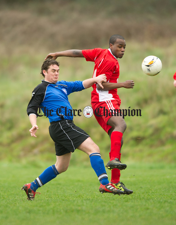 Cathal Jones of Bunratty/Cratloe in action against Benny Ayadola of Lifford B during their Division 3 game at Bunratty. Photograph by John Kelly.