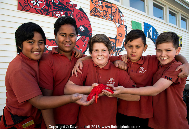 Makerspace artificial hand makers with the finished product, at Douglas Park School. Masterton District Council photoshoot in Masterton, New Zealand on Tuesday, 5 July 2015. Photo: Dave Lintott / lintottphoto.co.nz