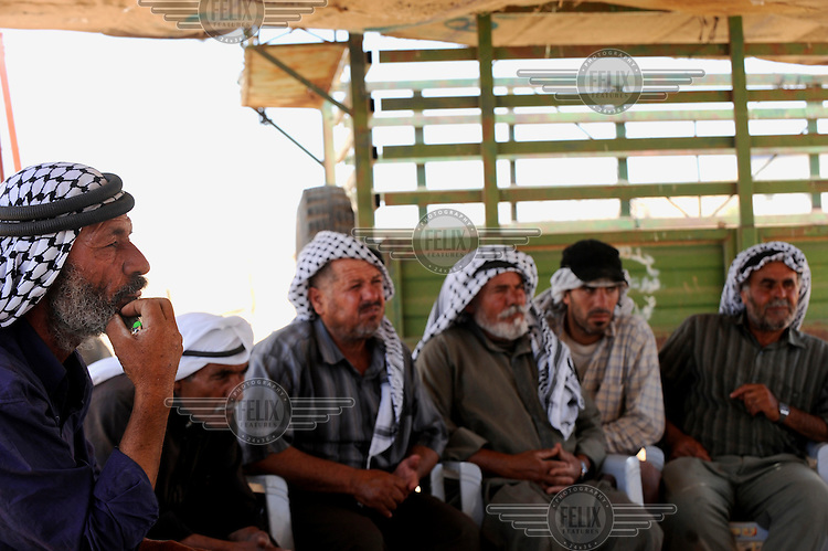 Bedouin men gather in a hosting tent for a debate about their present situation living in an encampments in the Hadidiyeh area. Bedouin living in the Hadidiyeh area which lies close to the Israeli settlement of Ro'ee and in a declared military fire zone, are threatened with eviction orders issued by Israeli authorities.
