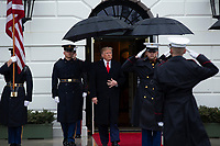 United States President Donald J. Trump, center, awaits the arrival of the Prime Minister of Greece Kyriakos Mitsotakis and his wife Mareva Grabowski outside of the White House in Washington, D.C., U.S., on Tuesday, January 7, 2020.<br /> <br /> Credit: Stefani Reynolds / CNP/AdMedia