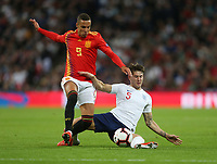 England's John Stones challenges Spain's Rodrigo<br /> <br /> Photographer Rob Newell/CameraSport<br /> <br /> UEFA Nations League - League A - Group 4 - England v Spain - Saturday September 8th 2018 - Wembley Stadium - London<br /> <br /> World Copyright &copy; 2018 CameraSport. All rights reserved. 43 Linden Ave. Countesthorpe. Leicester. England. LE8 5PG - Tel: +44 (0) 116 277 4147 - admin@camerasport.com - www.camerasport.com
