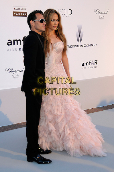 MARC ANTHONY, JENNIFER LOPEZ.arrivals at amfAR's Cinema Against AIDS 2010 benefit gala at the Hotel du Cap, Antibes, Cannes, France during the Cannes Film Festival.20th May 2010.amfAR full length black suit married husband wife jlo peach pale pink tulle gown dress long maxi ballgown silk ruffles ruffle .CAP/CAS.©Bob Cass/Capital Pictures.