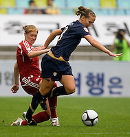 USWNT forward (8) Lauren Cheney is fouled by Canada's (4) Clare rustad during the finals of the Peace Queen Cup.  The USWNT defeated Canada, 1-0, at Suwon World Cup Stadium in Suwon, South Korea.