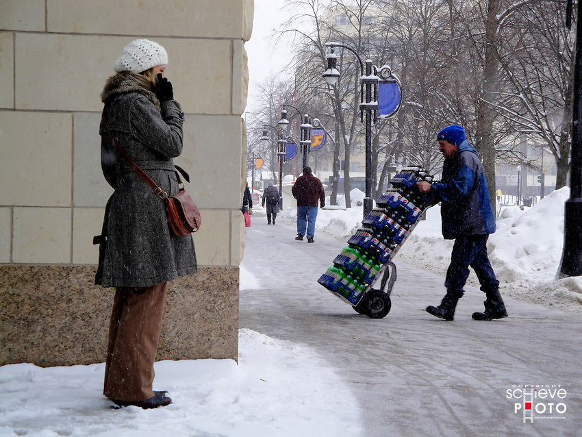 Woman talks on cell phone during a winter snow storm in downtown Madison, Wisconsin.